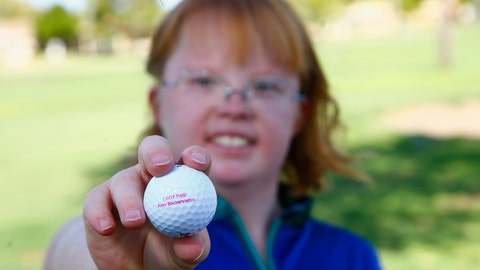 <p>               In this Aug. 28, 2019, photo, Amy Bockerstette, the golfer with Down syndrome who was an internet sensation by making par at the 16th hole at the Phoenix Open with soon-to-be 2019 U.S. Open champion Gary Woodland, smiles as she holds up a personalized logo golf ball after her golf lesson at Palmbrook Country Club in Sun City, Ariz. (AP Photo/Ross D. Franklin)             </p>