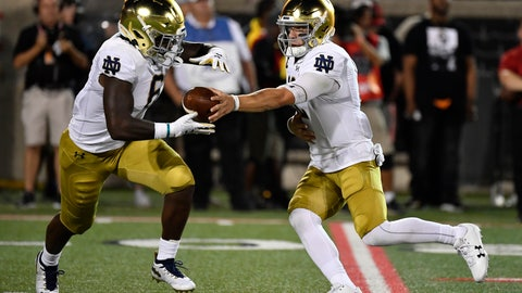 <p>               Notre Dame quarterback Ian Book (12) hands the ball off to running back Tony Jones Jr. (6) during the first half of an NCAA college football game in Louisville, Ky., Monday, Sept. 2, 2019. (AP Photo/Timothy D. Easley)             </p>