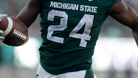 <p>               Michigan State's Elijah Collins rushes for a touchdown against Arizona State during the fourth quarter of an NCAA college football game Saturday, Sept. 14, 2019, in East Lansing, Mich. (AP Photo/Al Goldis)             </p>