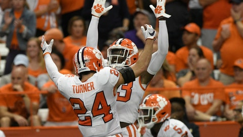 <p>               Clemson players Nolan Turner and Lyn-J Dixon celebrate a touchdown against Syracuse during an NCAA college football game Saturday, Sept. 14, 2019, in Syracuse, N.Y. (AP Photo/Steve Jacobs)             </p>