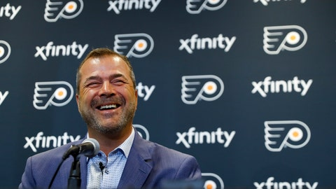 <p>               In this April 18, 2019 photo, Philadelphia Flyers head coach Alain Vigneault smiles during his introductory press conference at the Flyer's practice facility in Voorhees, N.J. Vigneault, a master of quick fixes who led Vancouver and the New York Rangers to the Stanley Cup Final, was hired as the latest coach to try and win a championship for the Flyers. (AP Photo/Matt Slocum)             </p>