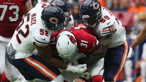 <p>               FILE - In  this Sept. 23, 2018, file photo, Chicago Bears linebacker Khalil Mack (52) makes a tackle on Arizona Cardinals running back David Johnson (31) with help from Danny Trevathan (59) during the first half of an NFL football game in Glendale, Ariz. Trevathan returns with the Bears on Sunday, Sept. 15, 2019, to Denver, where he played from 2012-15 and won a Super Bowl. (AP Photo/Ralph Freso, File)             </p>