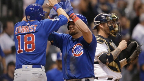 <p>               Chicago Cubs' Kyle Schwarber, middle, gets a high-five from Ben Zobrist after Schwarber's grand slam against the Milwaukee Brewers during the sixth inning of a baseball game Thursday, Sept. 5, 2019, in Milwaukee. (AP Photo/Jeffrey Phelps)             </p>