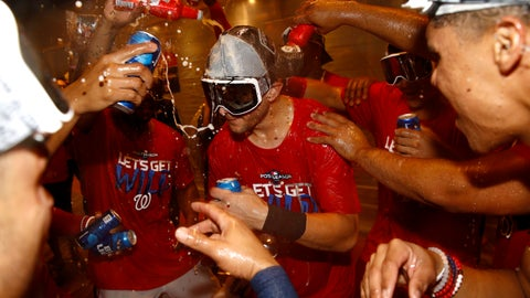 <p>               Washington Nationals shortstop Trea Turner, center, celebrates with teammates after the second baseball game of a doubleheader against the Philadelphia Phillies, Tuesday, Sept. 24, 2019, in Washington. Washington won 6-5 and clinched a Wild Card berth. (AP Photo/Patrick Semansky)             </p>