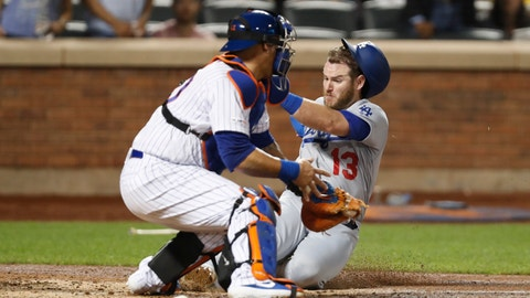 <p>               New York Mets catcher Wilson Ramos, left, has the ball in his glove but cannot make the tag in time as Los Angeles Dodgers' Max Muncy (13) scores on Cory Seager's fourth-inning RBI-single in a baseball game Sunday, Sept. 15, 2019, in New York. (AP Photo/Kathy Willens)             </p>
