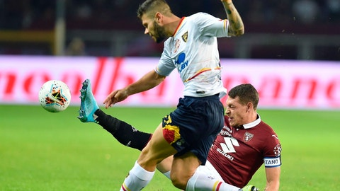 <p>               Torino's Andrea Belotti, right, and Lecce's Marco Calderoni battle for the ball during the Italian Serie A soccer match between Torino FC and US Lecce at the Olimpico Grande Torino stadium in Turin, Italy, Monday Sept. 16, 2019. (Alessandro Di Marco/ANSA via AP)             </p>