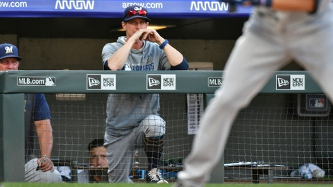 <p>               Milwaukee Brewers manager Craig Counsell, center, looks on during the 10th inning against the Colorado Rockies in a baseball game Sunday, Sept. 29, 2019, in Denver. (AP Photo/John Leyba)             </p>