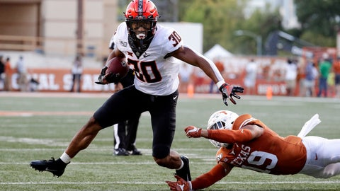 <p>               Oklahoma State running back Chuba Hubbard (30) runs past Texas defensive back Brandon Jones (19) during the first half of an NCAA college football game Saturday, Sept. 21, 2019, in Austin, Texas. (AP Photo/Eric Gay)             </p>