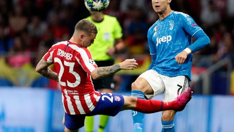 <p>               Juventus' Cristiano Ronaldo fights for the ball against Atletico Madrid's Kieran Trippier during the Champions League Group D soccer match between Atletico Madrid and Juventus at Wanda Metropolitano stadium in Madrid, Spain, Wednesday, Sept. 18, 2019. (AP Photo/Manu Fernandez)             </p>