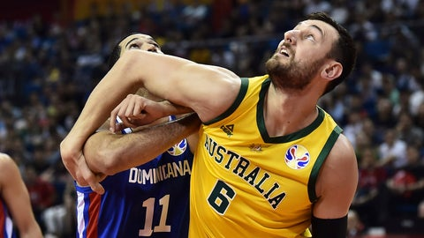<p>               Andrew Bogut of Australia battles for a rebound with Eloy Vargas of the Dominican Republic during their second round basketball game in the FIBA Basketball World Cup in Nanjing in eastern China's Jiangsu province, Saturday, Sept. 7, 2019. (AP Photo)             </p>