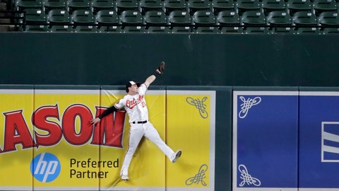 <p>               Baltimore Orioles center fielder Austin Hays makes the catch at the wall on a ball hit by Toronto Blue Jays' Vladimir Guerrero Jr. during the fourth inning of a baseball game Thursday, Sept. 19, 2019, in Baltimore. (AP Photo/Julio Cortez)             </p>