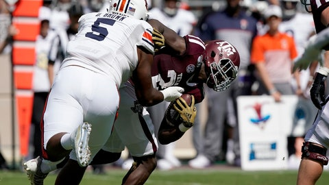 <p>               Auburn defensive tackle Derrick Brown (5) tackles Texas A&M running back Jacob Kibodi (23) for a loss during the first half of an NCAA college football game, Saturday, Sept. 21, 2019, in College Station, Texas. (AP Photo/Sam Craft)             </p>