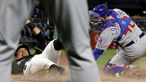 <p>               Pittsburgh Pirates' Jose Osuna, left, is framed by the legs of Chicago Cubs starting pitcher Jon Lester, as he scores past the attempted tag by catcher Willson Contreras on a double by Erik Gonzalez during the fourth inning of a baseball game in Pittsburgh, Wednesday, Sept. 25, 2019. (AP Photo/Gene J. Puskar)             </p>