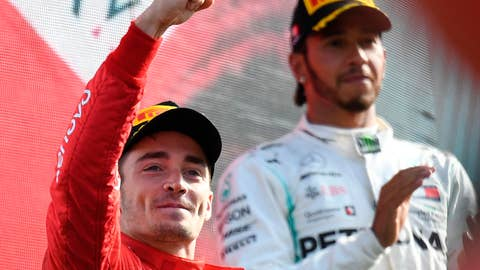 <p>               Ferrari driver Charles Leclerc of Monaco, left, celebrates with third placed Mercedes driver Lewis Hamilton of Britain, on podium after winning the Formula One Italy Grand Prix at the Monza racetrack, in Monza, Italy, Sunday, Sept.8, 2019. (AP Photo/Antonio Calanni) (Daniel Dal Zennaro/ANSA Via AP)             </p>