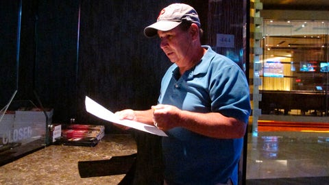 <p>               In this Sept. 4, 2019 photo, Andy Lanni of Oceanview, N.J. checks the odds at the sports book in the Borgata casino in Atlantic City, N.J. As the second NFL season begins following a U.S. Supreme Court decision clearing the way for legal sports betting, the industry is growing larger and ever-more mobile in the U.S. (AP Photo/Wayne Parry)             </p>