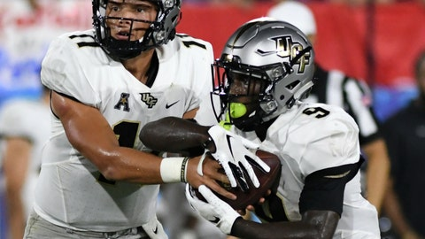 <p>               UCF quarterback Dillon Gabriel (11) hands the ball off to running back Adrian Killins Jr. (9) during the first half of an NCAA college football game against Florida Atlantic on Saturday, Sept. 7, 2019, in Boca Raton, Fla. (AP Photo/Jim Rassol)             </p>
