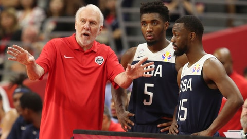 <p>               United States' coach Gregg Popovich, left talks to United States' Donovan Mitchell, center and United States' Kemba Walker at right for the FIBA Basketball World Cup in Dongguan in southern China's Guangdong province on Thursday, Sept. 12, 2019. The U.S. will leave the World Cup with its worst finish ever in a major international tournament, assured of finishing no better than seventh after falling to Serbia 94-89 in a consolation playoff game on Thursday night. (AP Photo/Ng Han Guan)             </p>