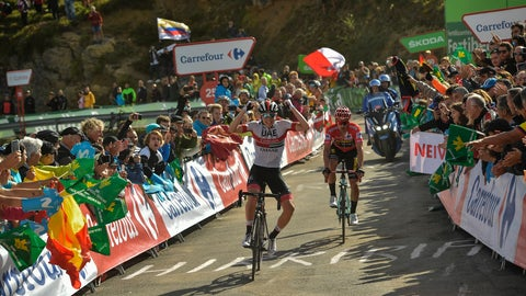 <p>               UAE Emirates' Team Tadej Pogacar of Slovenia, left, celebrates after winning the stage beside La Vuelta red shirt leaders, Jumbo -Visma's Team Primoz Roglic of Slovenia at the end of the 13th stage between Bilbao-Los Machucos Monumento Vaca Pasiega, 166,4 km kilometers (103,39miles), of the Spanish Vuelta cycling race that finishes Los Machucos, near to San Roque de Riomera, northern Spain, Friday, Sept. 6, 2019. (AP Photo/Alvaro Barrientos)             </p>