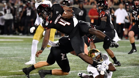<p>               Notre Dame cornerback Shaun Crawford (20) grabs the foot of Louisville quarterback Jawon Pass (4) during the first half of an NCAA college football game in Louisville, Ky., Monday, Sept. 2, 2019. (AP Photo/Timothy D. Easley)             </p>