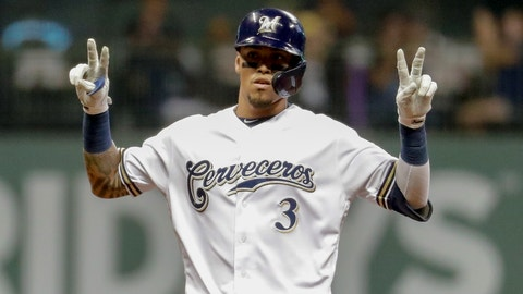 """<p>               Milwaukee Brewers' Orlando Arcia signals """"22"""" for teammate Christian Yelich after Arcia hit an RBI double during the sixth inning of a baseball game against the San Diego Padres Monday, Sept. 16, 2019, in Milwaukee. (AP Photo/Morry Gash)             </p>"""