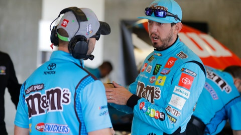 <p>               NASCAR driver Kyle Busch talks with a member of his crew after he qualified the NASCAR Brickyard 400 auto race at the Indianapolis Motor Speedway, Sunday, Sept. 8, 2019, in Indianapolis. (AP Photo/Darron Cummings)             </p>