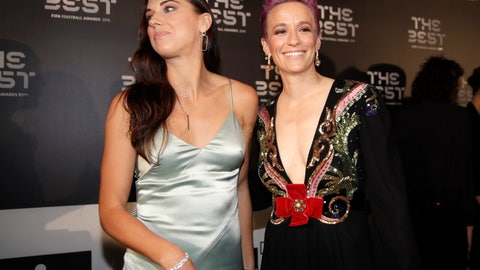 <p>               United States forward Megan Rapinoe, right, arrives with Sue Bird to attend the Best FIFA soccer awards, in Milan's La Scala theater, northern Italy, Monday, Sept. 23, 2019. Netherlands defender Virgil van Dijk is up against five-time winners Cristiano Ronaldo and Lionel Messi for the FIFA best player award and Rapinoe is the favorite for the women's award. (AP Photo/Luca Bruno)             </p>