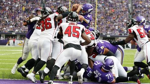 <p>               Minnesota Vikings quarterback Kirk Cousins (8) scores on a 1-yard touchdown run during the first half of an NFL football game against the Atlanta Falcons, Sunday, Sept. 8, 2019, in Minneapolis. (AP Photo/Bruce Kluckhohn)             </p>