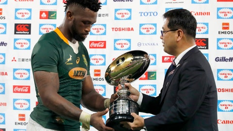 <p>               South Africa's Siya Kolisi receives a trophy after a rugby match against Japan at Kumagaya Rugby Stadium Friday, Sept. 6, 2019, in Saitama, Japan. South Africa won 41-7. (AP Photo/Eugene Hoshiko)             </p>