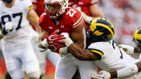 <p>               Wisconsin running back Jonathan Taylor, left, runs against Michigan's Khaleke Hudson, right, during the first half of an NCAA college football game Saturday, Sept. 21, 2019, in Madison, Wis. (AP Photo/Andy Manis)             </p>