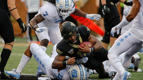 <p>               Wake Forest quarterback Jamie Newman (12) rushes for a touchdown over North Carolina defensive back Myles Wolfolk (11) during the first half of an NCAA college football game in Winston-Salem, N.C., Friday, Sept. 13, 2019. (AP Photo/Nell Redmond)             </p>