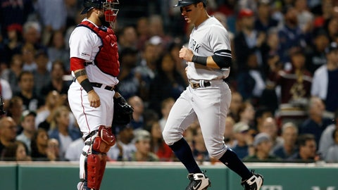 <p>               New York Yankees' Mike Tauchman, right, scores in front of Boston Red Sox's Sandy Leon on an RBI-single by Aaron Judge during the third inning of a baseball game in Boston, Sunday, Sept. 8, 2019. (AP Photo/Michael Dwyer)             </p>