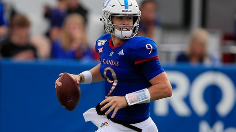 <p>               Kansas quarterback Carter Stanley looks for a receiver during the first half of an NCAA college football game against West Virginia in Lawrence, Kan., Saturday, Sept. 21, 2019. (AP Photo/Orlin Wagner)             </p>