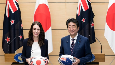 <p>               New Zealand's Prime Minister Jacinda Ardern, left, and Japan's Prime Minister Shinzo Abe hold rugby balls after a joint press conference following a meeting at Abe's official residence in Tokyo Thursday, Sept. 19, 2019. (Tomohiro Ohsumi/Pool Photo via AP)             </p>