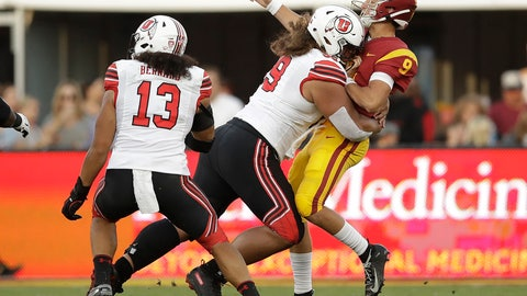 <p>               Southern California quarterback Kedon Slovis (9) is hit by by Utah defensive tackle Leki Fotu during the first half of an NCAA college football game Friday, Sept. 20, 2019, in Los Angeles. (AP Photo/Marcio Jose Sanchez)             </p>
