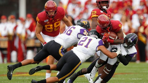 <p>               FILE - In this Aug. 31, 2019, file photo, Iowa State wide receiver Deshaunte Jones (8) is brought down by Northern Iowa's Trevon Alexander (36), Christian Jegen (21) and Spencer Perry (8) during the first half of an NCAA college football game, in Ames, Iowa. Iowa State needed triple overtime to beat Northern Iowa 29-26. (AP Photo/Matthew Putney, File)             </p>