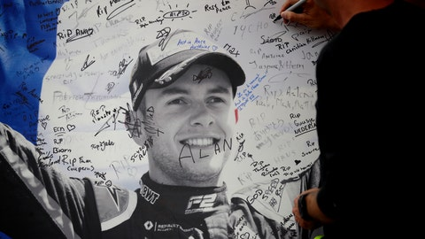 <p>               A man signs a remembrance board for Formula 2 driver Anthoine Hubert at the Belgian Formula One Grand Prix circuit in Spa-Francorchamps, Belgium, Sunday, Sept. 1, 2019. The 22-year-old Hubert died Saturday following an estimated 160 mph (257 kph) collision on Lap 2 at the high-speed Spa-Francorchamps track, which earlier Saturday saw qualifying for Sunday's Formula One race. (AP Photo/Francisco Seco)             </p>
