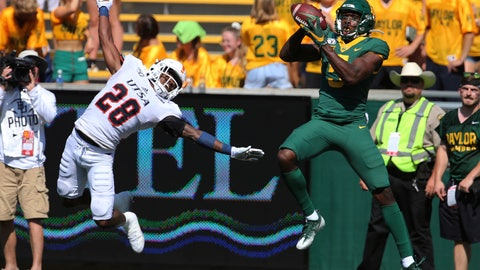 <p>               Baylor wide receiver Denzel Mims, right, pulls down a touchdown pass over UTSA cornerback Cassius Grady, left, in the first half of an NCAA college football game, Saturday, Sept. 7, 2019, in Waco, Texas. (Rod Aydelotte/Waco Tribune-Herald via AP)             </p>