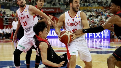 <p>               Turkey's Melih Mahmutoğlu reacts with the ball during a Group E match for the FIBA Basketball World Cup at the Shanghai Oriental Sports Center in Shanghai on Sunday, Sept. 1, 2019. Turkey defeats Japan 86-67. (AP Photo/Ng Han Guan)             </p>