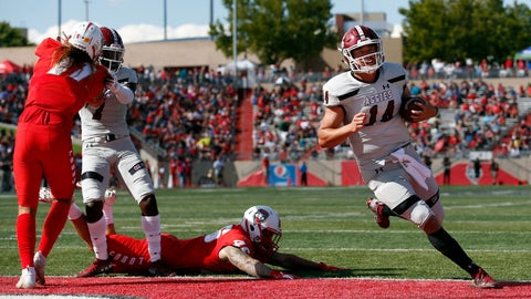 <p>               New Mexico State quarterback Josh Adkins (14) scores a touchdown during the first half of an NCAA college football game against New Mexico on Saturday, Sept. 21, 2019 in Albuquerque, N.M. (AP Photo/Andres Leighton)             </p>