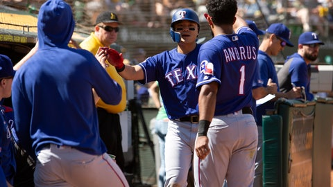 <p>               Texas Rangers' Shin-Soo Choo, center, is greeted by his teammates after scoring on a single by Danny Santana during the fourth inning of a baseball game against the Oakland Athletics, Sunday, Sept. 22, 2019, in Oakland, Calif. (AP Photo/D. Ross Cameron)             </p>