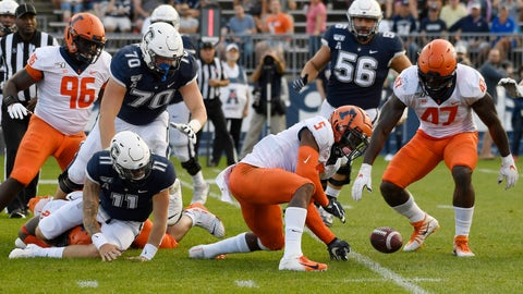 <p>               Illinois linebacker Milo Eifler (5) and Illinois defensive lineman Oluwole Betiku Jr. (47) reach to take possession of a ball fumbled by Connecticut quarterback Jack Zergiotis (11) during the second half of an NCAA college football game, Saturday, Sept. 7, 2019, in East Hartford, Conn. (AP Photo/Jessica Hill)             </p>