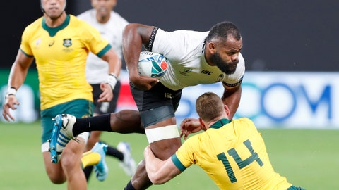 <p>               Fiji's Peceli Yato is tackled by Australia's Reece Hodge (14) during the Rugby World Cup Pool D game at Sapporo Dome between Australia and Fiji in Sapporo, northern Japan, Saturday, Sept. 21, 2019. (Masanori Takei/Kyodo News via AP)             </p>