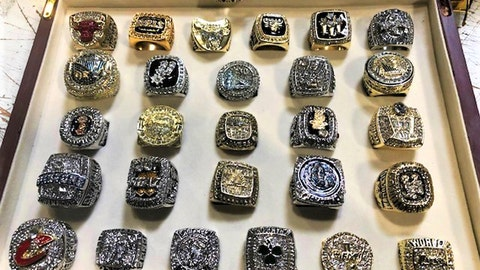 <p>               This undated photo provided by U.S. Customs and Border Protection shows a collection of counterfeit NBA championship rings that have been seized by federal authorities at Los Angeles International Airport. CBP said Wednesday, Sept. 11, 2019 that the rings were in a wooden box shipped from China with a final destination in Arizona. Investigators suspect the intent was to sell the phony rings as a collection. (U.S. Customs and Border Protection via AP)             </p>