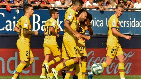 <p>               FC Barcelona player Ansu Fati, second right, is congratulated by teammates after scoring during the Spanish La Liga soccer match against Osasuna, at El Sadar stadium, in Pamplona, northern Spain, Saturday, Aug. 31, 2019. (AP Photo/Alvaro Barrientos)             </p>