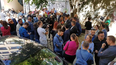 <p>               Journalists protest outside the offices of soccer club Sarajevo in Sarajevo, Bosnia, Monday, Sept. 30, 2019. Several dozen journalists protested in Bosnia after assailants forced online staff of a radio station to revoke a news item. Police have detained two people over the incident on Friday when assailants who said they were soccer fans threatened the staff of radiosarajevo.ba news portal until they removed the news that a fan of soccer club Sarajevo received five years in prison in Belarus for cocaine possession. (Journalists Union of Bosnia Hercegovina via AP)             </p>