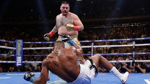 <p>               FILE - In this June 1, 2019, file photo, Andy Ruiz, above, knocks down British boxer Anthony Joshua during the third round of a heavyweight championship boxing match in New York. Three months ago in New York, Andy Ruiz scored a massive upset when he took Anthony Joshua's three heavyweight belts. (AP Photo/Frank Franklin II, File)             </p>
