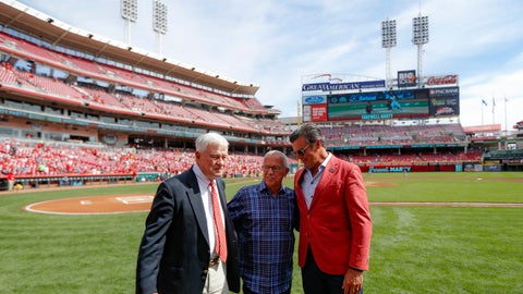 <p>               Cincinnati Reds announcer Marty Brennaman, center, stands with Reds owner Bob Castellini, left, and Phil Castellini, right, before a baseball game against the Milwaukee Brewers, Thursday, Sept. 26, 2019, in Cincinnati. The 77-year-old broadcaster is retiring after 46 years. (AP Photo/John Minchillo)             </p>