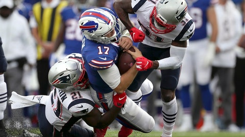 <p>               New England Patriots defenders Jonathan Jones (31) and Duron Harmon (21) tackle Buffalo Bills quarterback Josh Allen (17) in the second half of an NFL football game, Sunday, Sept. 29, 2019, in Orchard Park, N.Y. Allen left the field after the play. (AP Photo/Ron Schwane)             </p>