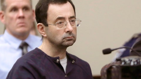 """<p>               FILE - In this Jan. 24, 2018, file photo, Larry Nassar, a former doctor for USA Gymnastics and member of Michigan State's sports medicine staff, sits in court during his sentencing hearing in Lansing, Mich. MSU is defending itself against a second wave of lawsuits related to Nassar but says it wants to reach a deal with the additional assault victims. MSU defended itself in a court filing Monday, Aug. 26, 2019. It says it's immune to liability for Nassar's crimes, no matter how """"repugnant."""" (AP Photo/Carlos Osorio, File)             </p>"""