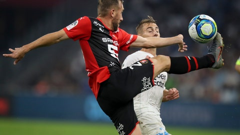 <p>               Rennes' Flavian Tait and Marseille's Valentin Rongier battle for the ball during the French League One soccer match between Marseille and Rennes at the Velodrome stadium in Marseille, southern France, Sunday, Sept. 29, 2019. (AP Photo/Daniel Cole)             </p>